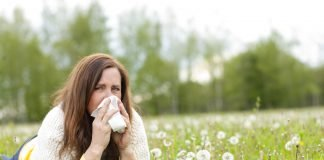 Grass pollen - woman sneezing